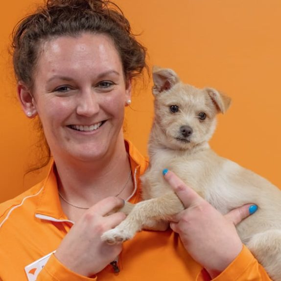 Wagly staff member with dog